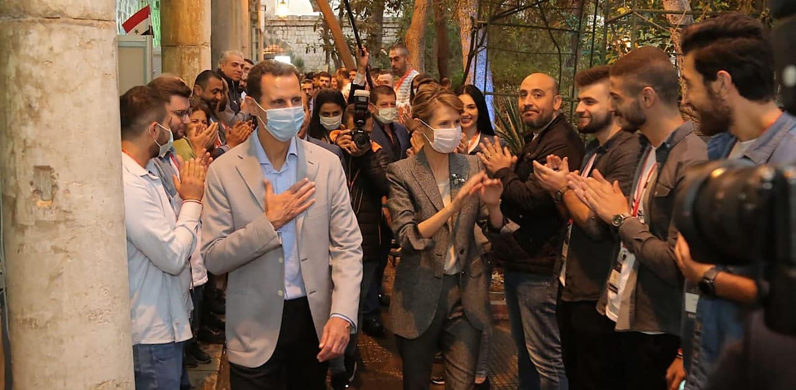 נשיא סוריה בשאר אל אסד ואישתו אסמה מבקרים בעלי עסקים בזמן הקורונה / צילום: Reuters, SalamPix/ABACAPRESS.COM