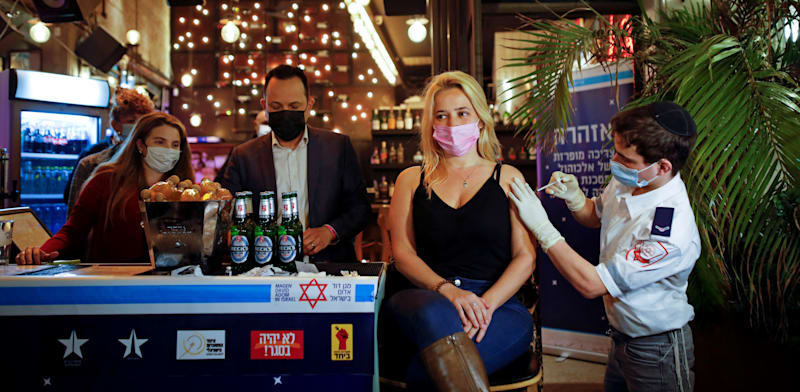 Vaccination in an Israeli pub Photo: Corinna Kern Reuters