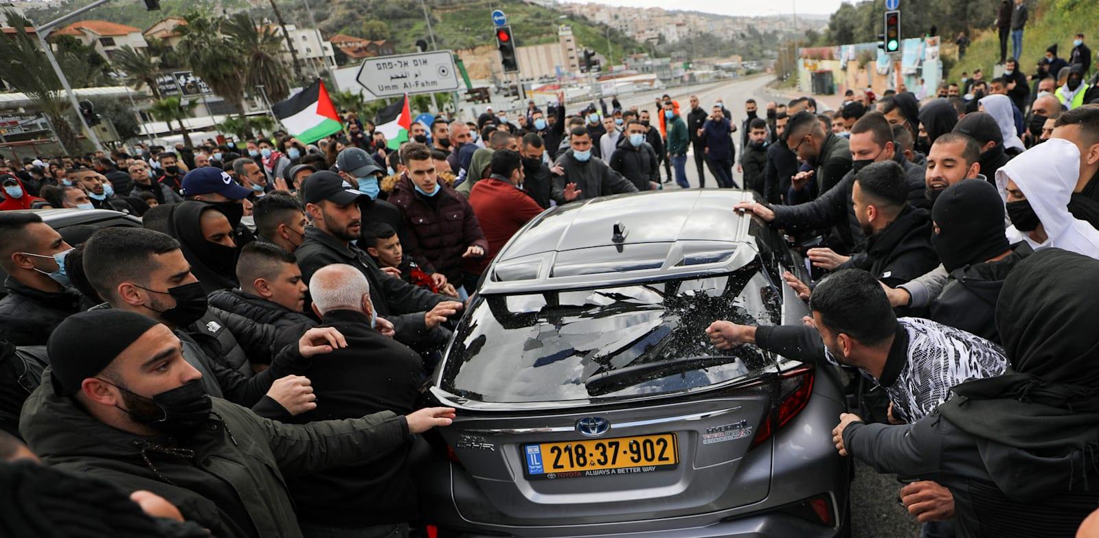 הפגנה באום אל פאחם נגד ההתעלמות המשטרתית מהפשיעה בחברה הערבית / צילום: Reuters, AMMAR AWAD