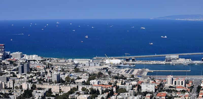 Ships wait out at seas for a berth in Haifa Port Photo: Paul Orlev