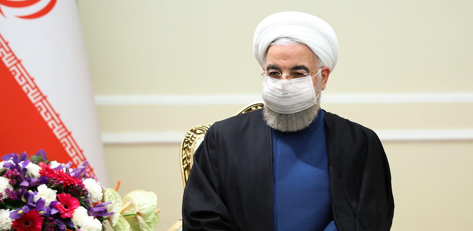 נשיא איראן חסן רוחאני / צילום: Associated Press, Russian Foreign Ministry Press Service