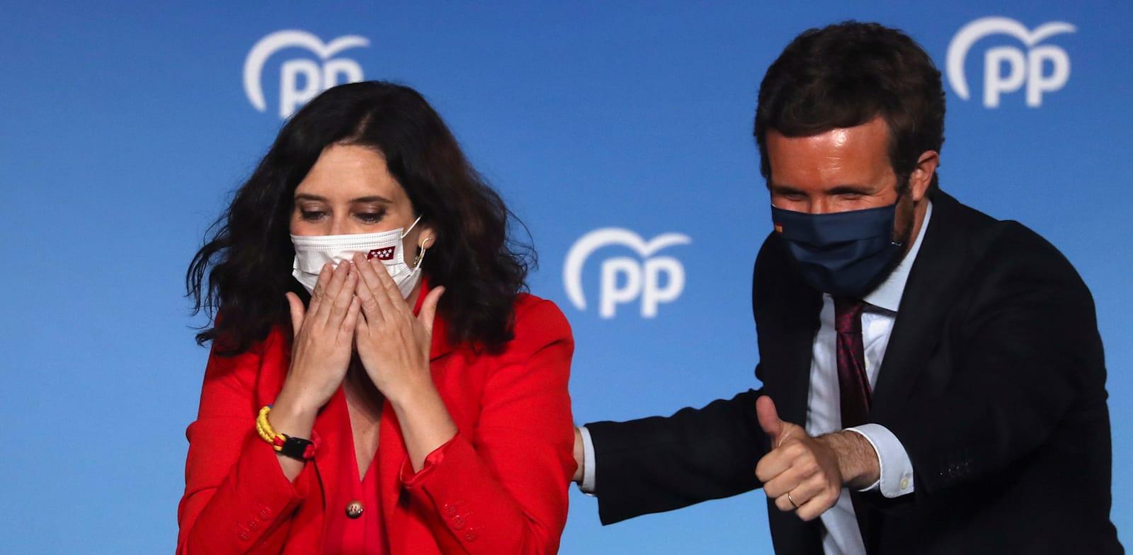 איזבל דיאז איוסו ופאבלו קאסאדו חוגגים את תוצאות הבחירות / צילום: Reuters, Susana Vera