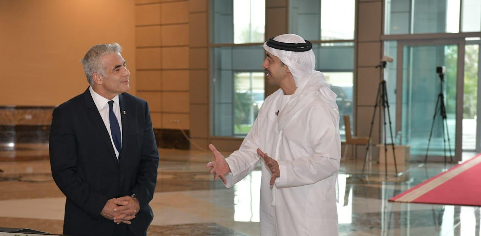 Yair Lapid with UAE Foreign Minister Sheikh Abdullah bin Zayed bin Sultan Al Nahyan  credit: Shlomi Amsalem, GPO