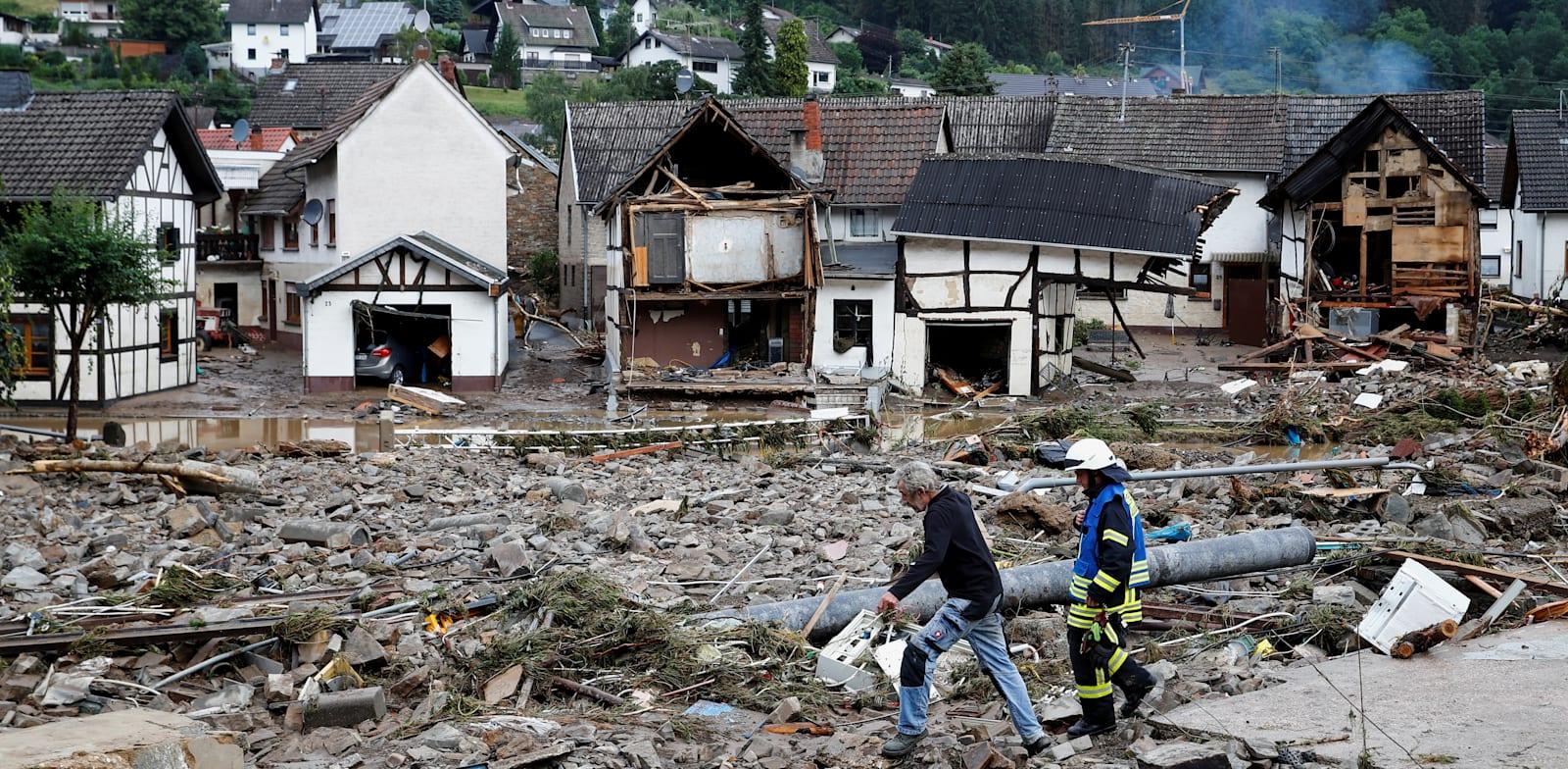 הרס רב בעיירה שולד בגרמניה בשל הצפות / צילום: Reuters, Wolfgang Rattay