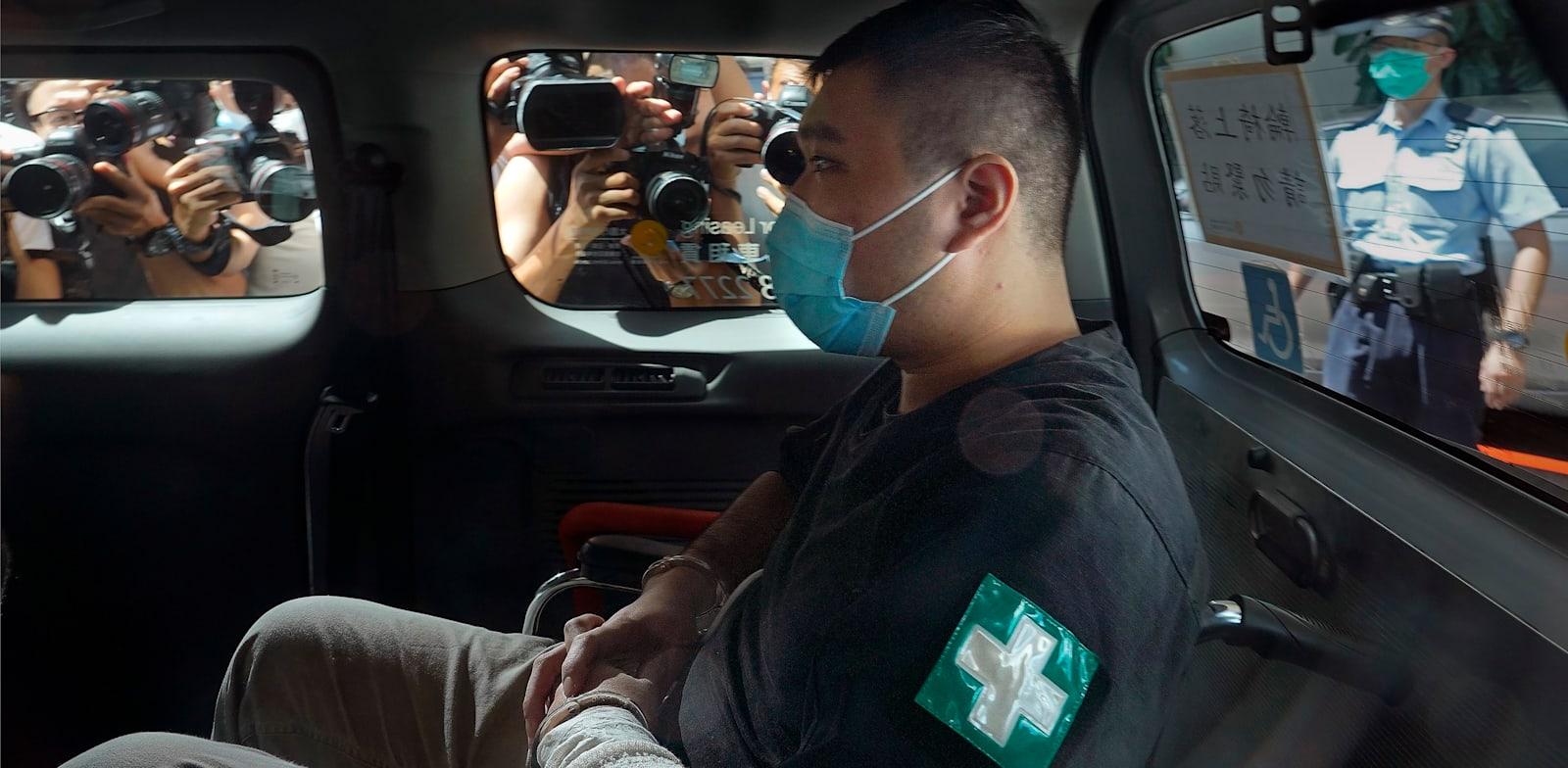 טונג יינג-קיט לפני דיון בעניינו בשנה שעברה / צילום: Associated Press, Vincent Yu