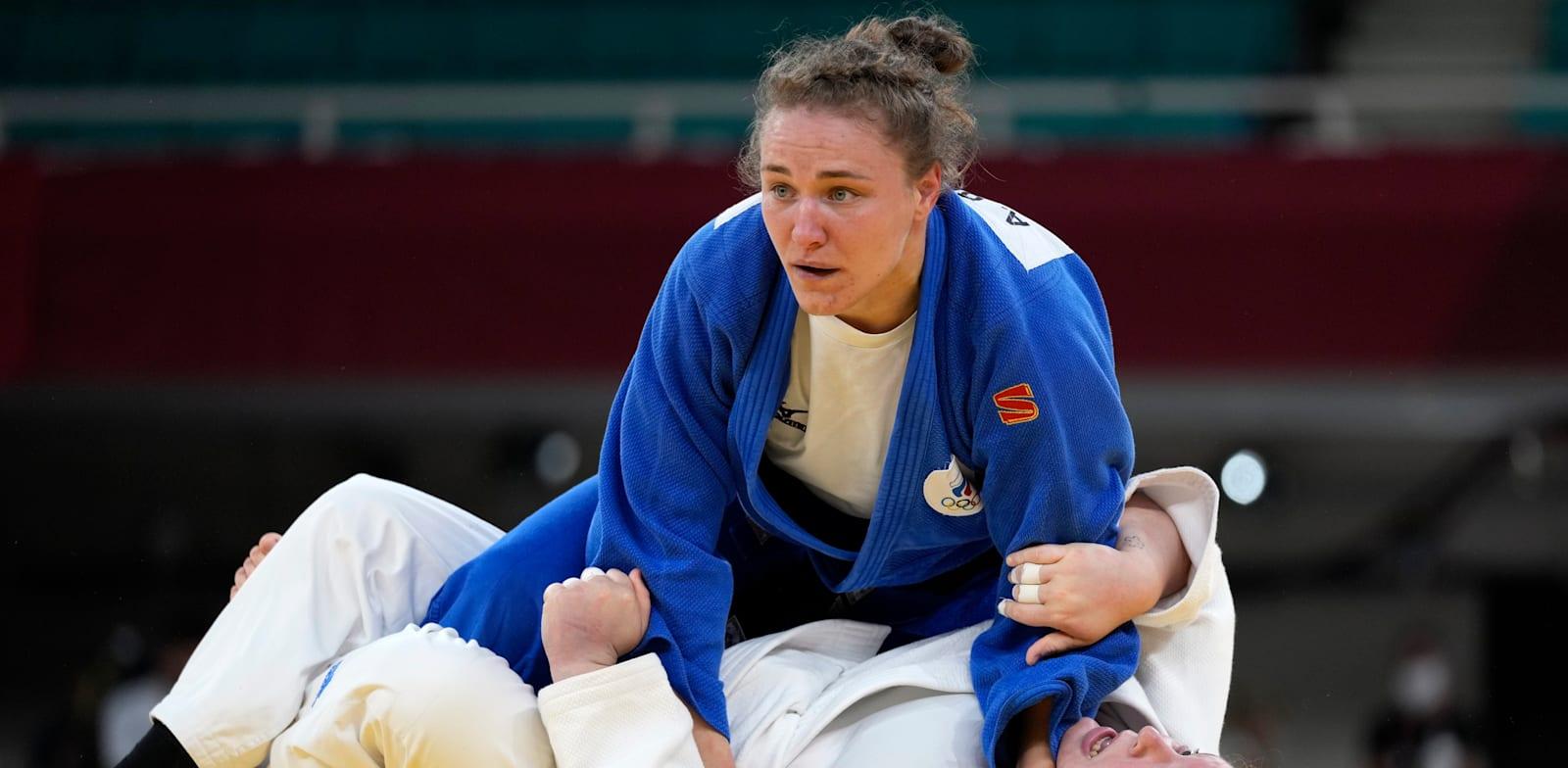 רז הרשקו מנצחת באיפון את אלכסנדרה בבינצבה / צילום: Associated Press, Vincent Thian