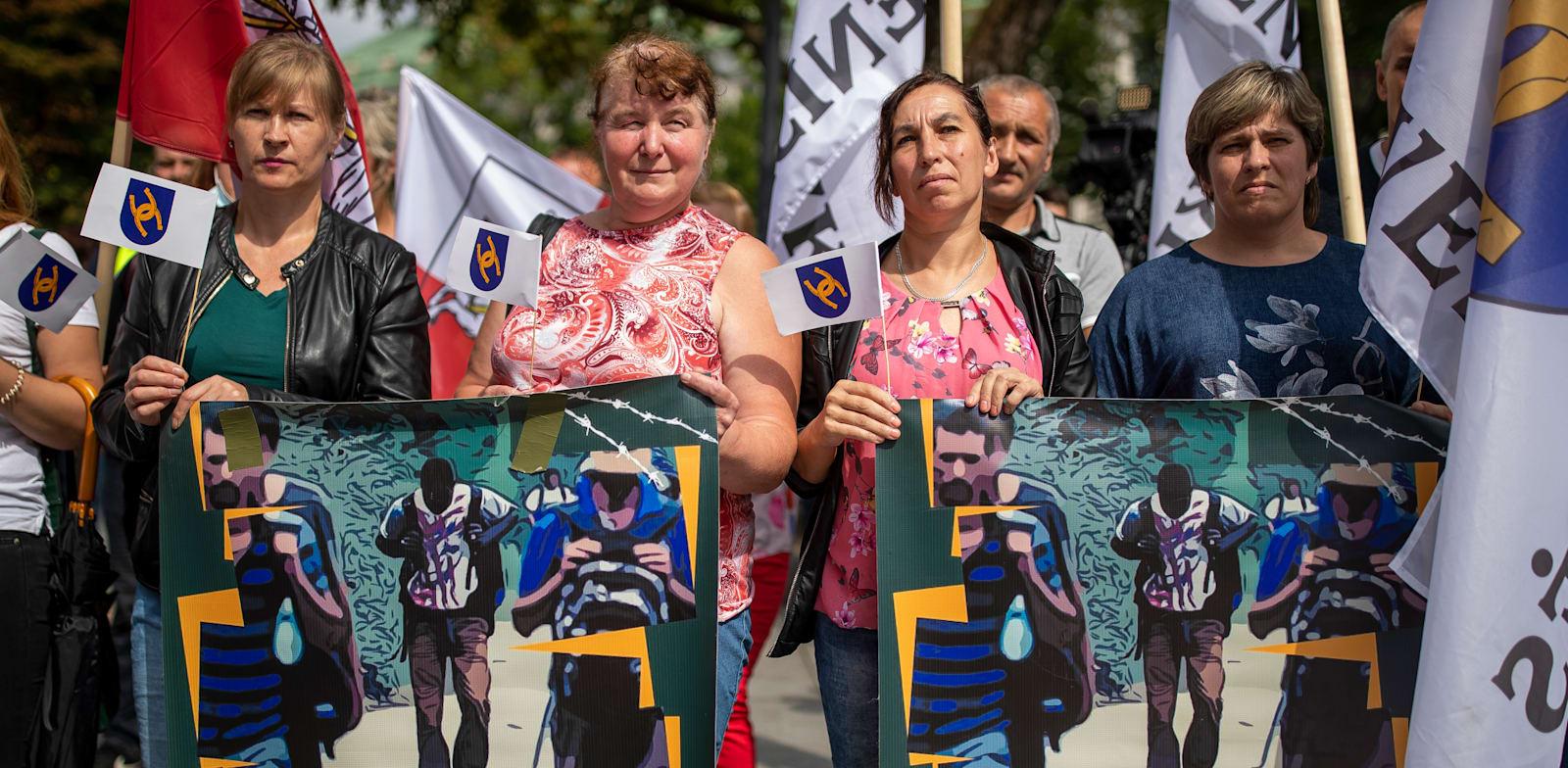 הפגנה בליטא בשבוע שעבר נגד כניסת המהגרים מבלארוס / צילום: Associated Press, Mindaugas Kulbis