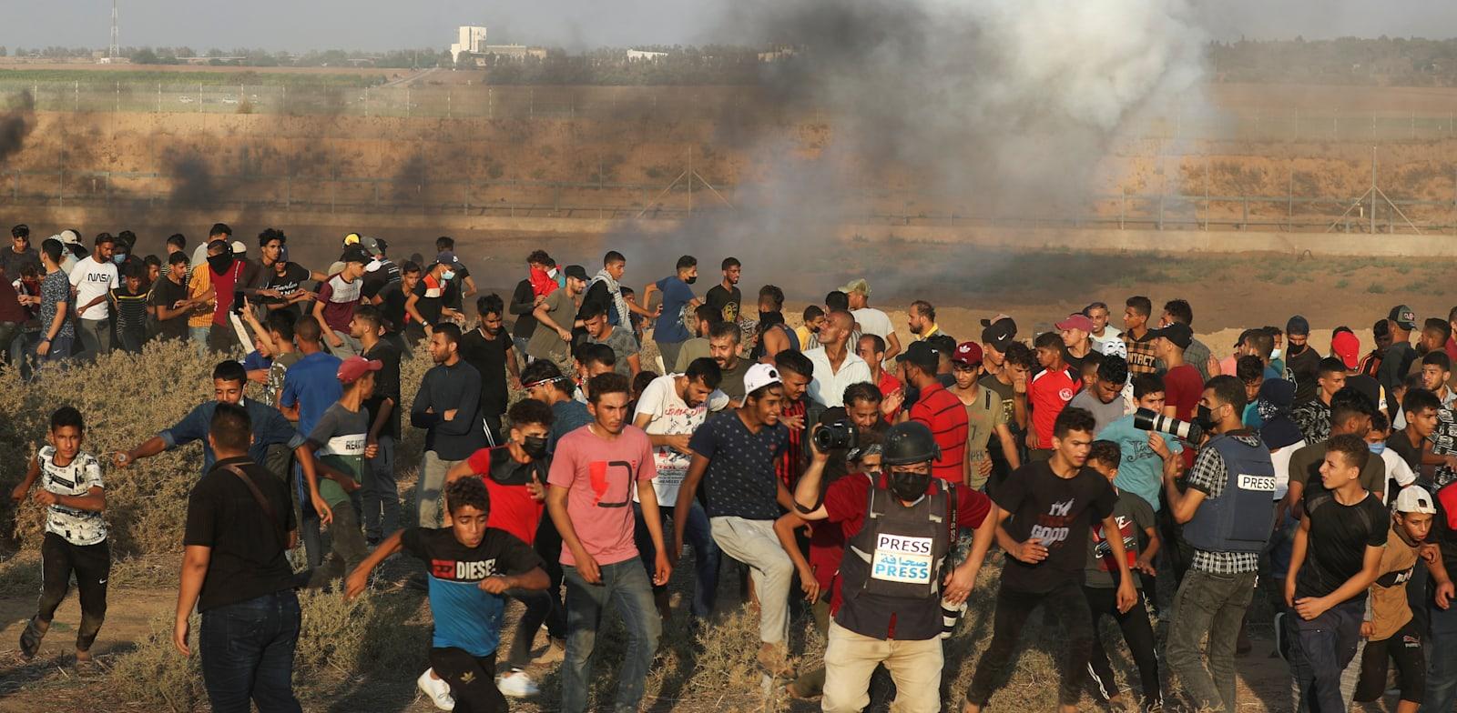 הפגנה על הגדר בגבול רצועת עזה, 28.08.2021 / צילום: Reuters, Mohammed Salem