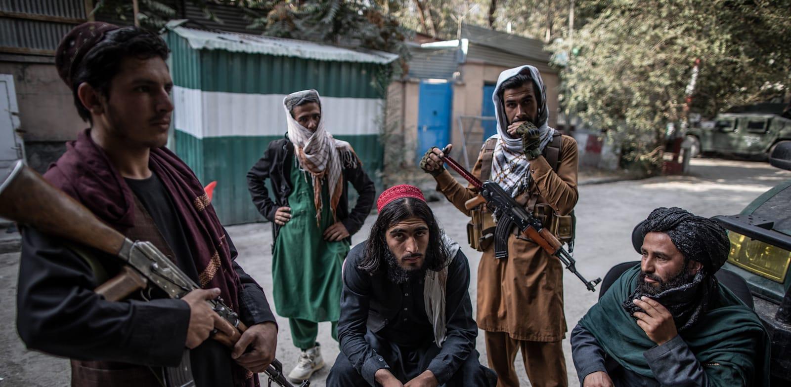לוחמי טליבאן בקאבול / צילום: Reuters, Oliver Weiken