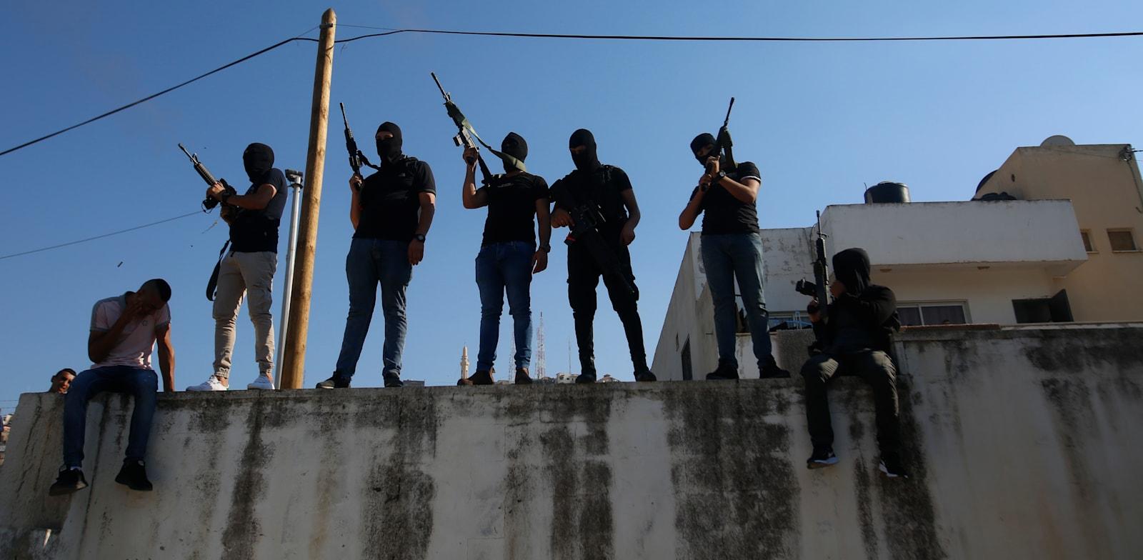 חמושים פלסטינים ברחובות ג'נין / צילום: Associated Press, Majdi Mohammed