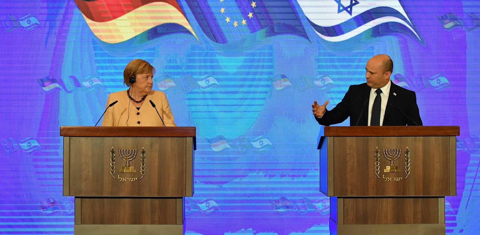 """ראש הממשלה נפתלי בנט וקנצלרית גרמניה היוצאת אנגלה מרקל / צילום: יואב דודקביץ', """"ידיעות אחרונות"""""""