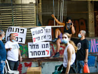 """הפגנה שוק הכרמל ת""""א לפתיחת המסחר / צילום: שלומי יוסף"""