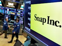 לוגו חברת סנאפ במסכים בוול סטריט / צילום: Associated Press, Richard Drew