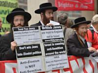 החברה החרדית בבריטניה מפגינה נגד הגדרות האנטישמיות של ה-IHRA / צילום: Reuters, Nick Ansell