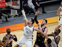 משחק NBA בין המילווקי באקס והפניקס סאנס / צילום: ג'ואי קמפרואילה