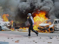 פגיעה ישירה ברכב באשקלון / צילום: Associated Press, Ariel Schalit