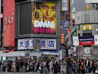 הביטקוין על שלט חוצות ביפן / צילום: Associated Press, Shizuo Kambayashi