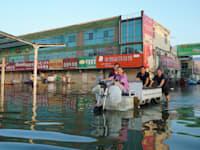 נזקי ההצפות בסין / צילום: Associated Press, Dake Kang