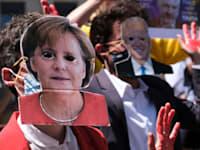 הפגנה נגדל אנגלה מרקל לפני ישיבת פסגה בנאט''ו / צילום: Shutterstock