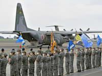 מטוס הרקולס C-130 של צבא יפן, לפני ההמראה למבצע הפינוי / צילום: Reuters, Kyodo