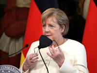 מרקל בביקורה בימים האחרונים באיטליה / צילום: Reuters, Andrew Medichini/Pool via REUTERS