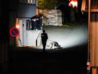 שוטר נורבגי חוקר את הרצח בעיירה קונגסברג / צילום: Reuters, NTB