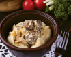 Вареники з картоплею та грибами, подаються з курячою печінкою в сметанному соусі (280г)