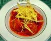 Albóndigas con tomate fresco y patatas paja