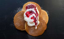 Pancakes with raspberries and sour cream
