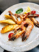 Tiger shrimps in garlic wine sauce with lemon juice