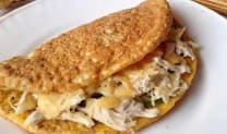 Oat pancake with chicken, mushrooms and cheese sauce
