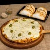 Docena de empanadas a elección + pizza grande de mozzarella