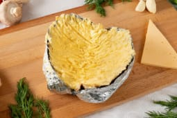 Baked potato with butter and cheese