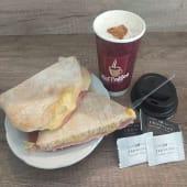 Café con Leche + Tostado de Pan Árabe