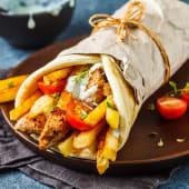 Грецька шаурма Порк сувлакі з картоплею фрі і соусом дзадзикі (450г)