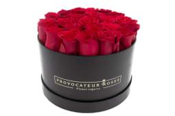 Caja redonda con 17-21 rosas rojas frescas