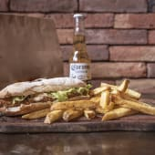 Sándwich de milanesa de bife de chorizo + papas fritas