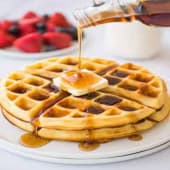 A golden crispy waffle served with butter & maple syrup