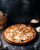 Oferta #1: Pizza Familiar + Pan Al Ajo + Gaseosa