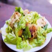 Caesar Salad served with chicken chunks
