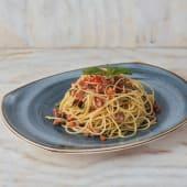 Spaguetti con prosciutto al tiro