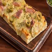 Pizza de jamón y aceitunas