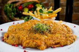 Grand schnitzel și cartofi piure