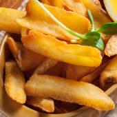 Картопляні діпи з сирно-часниковим соусом (140/30г)