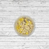 Yogur con muesli y fruta a elegir (mango o piña)