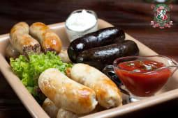 М'ясна ковбаска з соусом Барбекю (250/50г)
