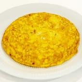 12. Tortilla melosa de patatas y cebolla pochada