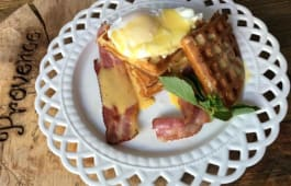 Cheddar Waffles with cottage cheese, poached egg and bacon