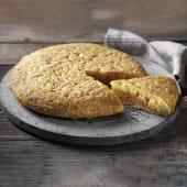 Tortilla de cecina, queso de cabra y cebolla caramelizada
