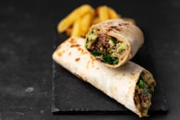 Braised pulled beef with guacamole wrap